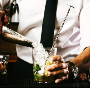 Bartender Pouring ice into a glass